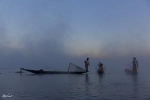 Intha fishermen in the mist at sunrise